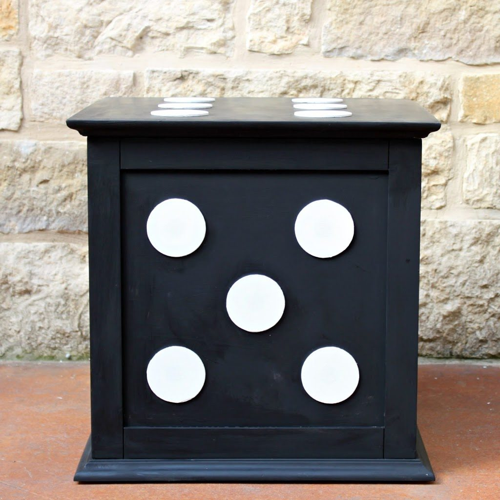 Turn a boring storage piece into a fun piece of decor by using wood pieces and chalk paint.