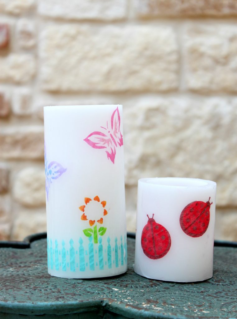 Stenciled candles are beautiful and easy to make. Learn how to create your own custom home decor with this detailed tutorial.