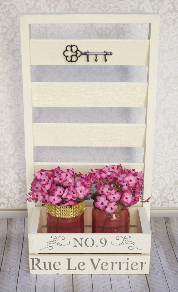 To help organize my space and decorate at the same time I created this shabby chic shutter shelf storage. It looks good and can be used as an organizer or as a decorative piece!