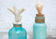 Make coastal bottle decor to bring the beach home with you. Use glass paint and souvenir shells to create beach themed home decor.
