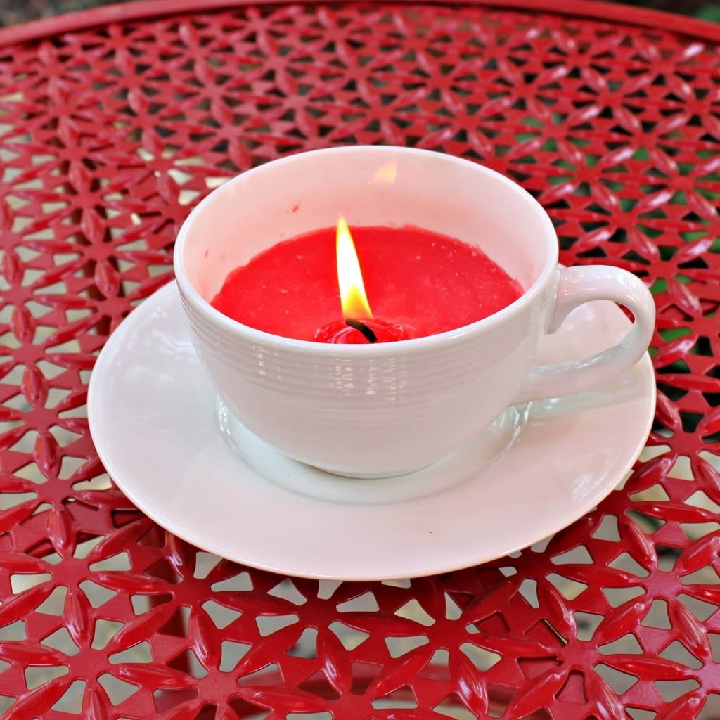 Use thrifted cups, saucers, and candles to create a lovely tea cup candle. These candles are just perfect for summer nights!