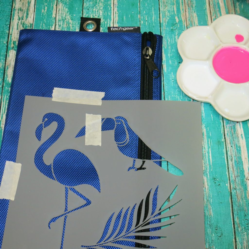 Make a flamingo pencil pouch by using fun DecoArt stencils and your own DIY fabric paint. Create colorful custom designs for back to school.