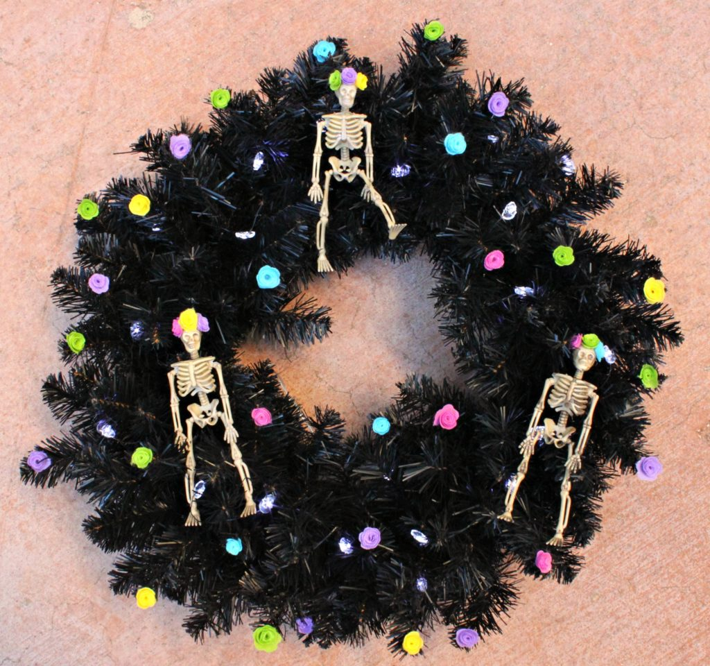 Make a sugar skull wreath the decorate your front door with this Halloween.  This fun and festive decor is easy to make and looks great.