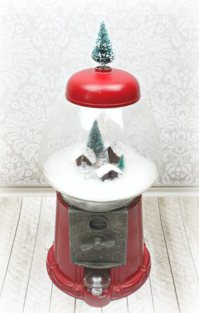 Make a gumball machine snow globe using a thrift store item with various craft supplies. Make adorable holiday Christmas and winter decor!
