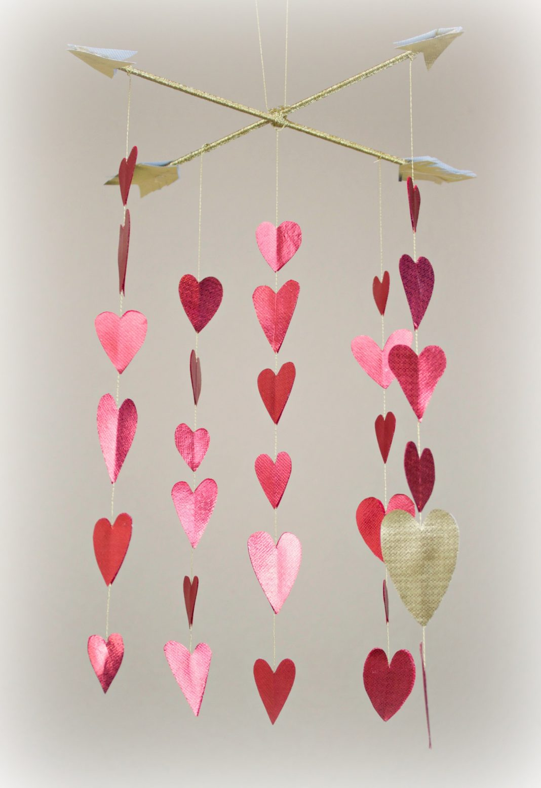 Make a shimmery heart mobile to decorate your room with for Valentine's day!