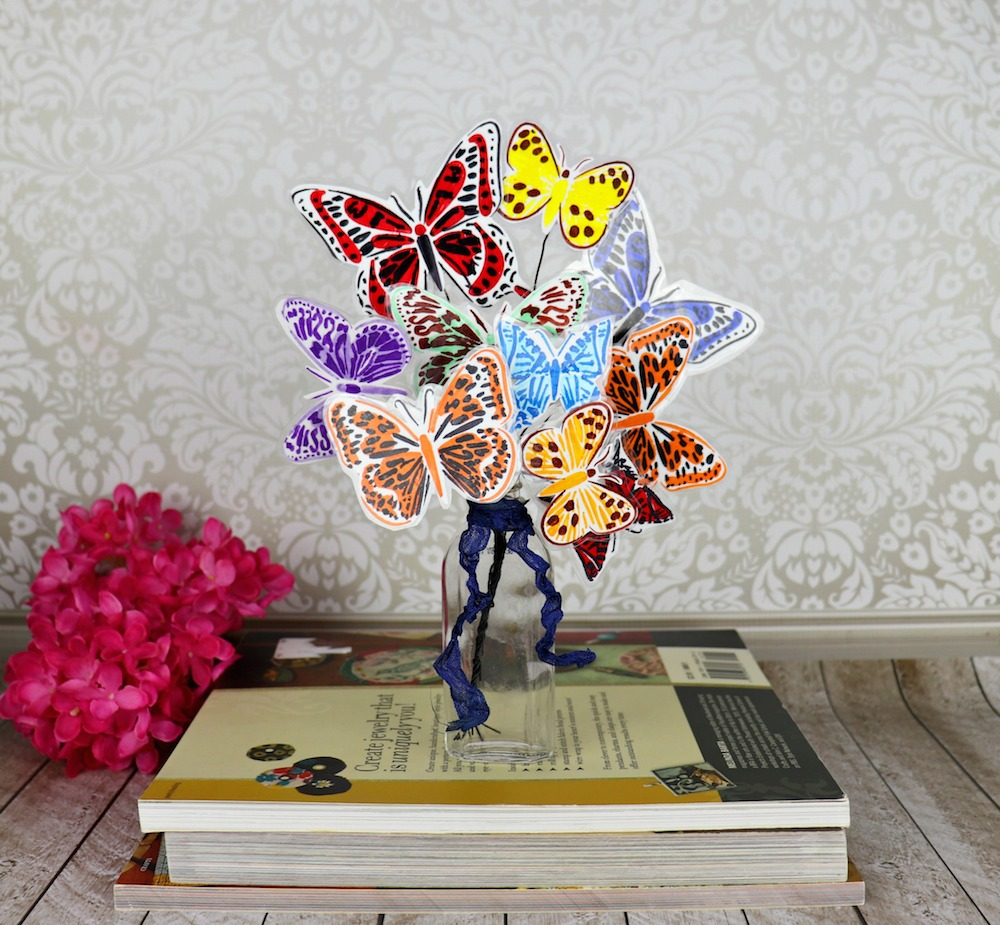 Make a butterfly bouquet to brighten any space with! Use layered stencils with markers and cold laminate to create colorful decor.