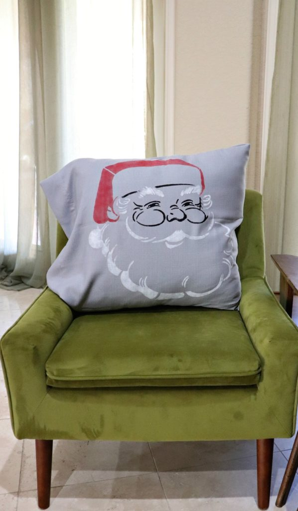 This retro Santa Claus pillow DIY is a quick project. Use curtain panels from Goodwill San Antonio with stencils and paint to whip up this project!